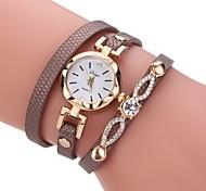 Недорогие -Жен. Модные часы Часы-браслет Уникальный творческий часы Китайский Кварцевый PU Группа Винтаж С подвесками Элегантные часы Повседневная