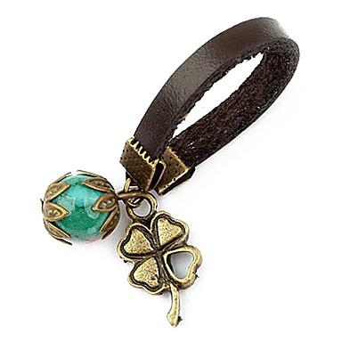 Perlas de color y el anillo del trébol con banda elástica